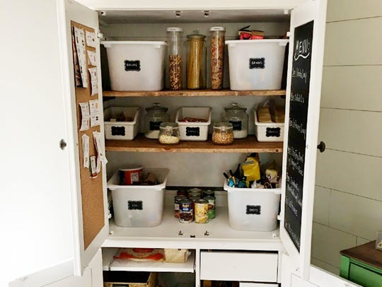 """Abbie Ridley's """"new pantry"""" offers a lot of space for groceries and looks neat inside and out. She added cork to the inside of one of the doors , and used chalkboard paint on the other one so she could use it for the week's menu.  The total cost of her project was $88."""
