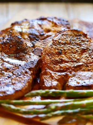 Marinade for grilled pork chops includes soy sauce and garlic.