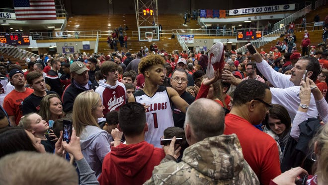 New Albany's Romeo Langford (1) is surrounded by fans as he signs autographs after the Class 4A regional championship at Seymour High School on Saturday, March 10, 2018. New Albany defeated Center Grove 69-56.