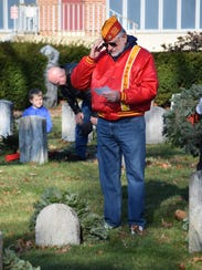 Matt Jordan of Vineland salutes as he reads the graveside