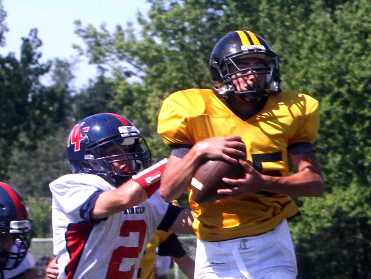 Nanuet's Mike Zaro catches a touchdown pass over a New Fairfield. Conn. defender during a multi-team football scrimmage at Brewster High School Aug. 27, 2016. Several area teams took part in the scrimmage in advance of next weekend's season opening games.