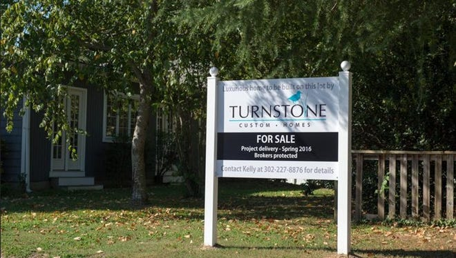 Signage for an empty lot where a home is proposed to be built on Laurel St in Rehoboth Beach.