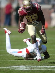 Florida State's wide receiver Keith Gavin dodges a hornet during FSU's takedown of Delaware State on Nov. 18, 2017.