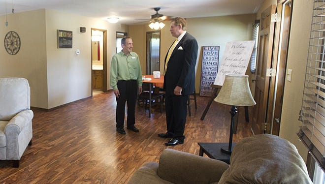 Luke Muraski, director of special living services, and David A. Boelter, executive director at The Arc of Fond du Lac, talk in the living room of the new respite house at 620 South Marr St. The home will offer high-quality living conditions for special-needs patients, allowing their caregivers the freedom to travel or complete projects.