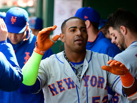 New York Mets left fielder Yoenis Cespedes (52) celebrates with teammates after hitting a solo home run during the fourth inning off Washington Nationals starting pitcher Stephen Strasburg (not pictured)  at Nationals Park.