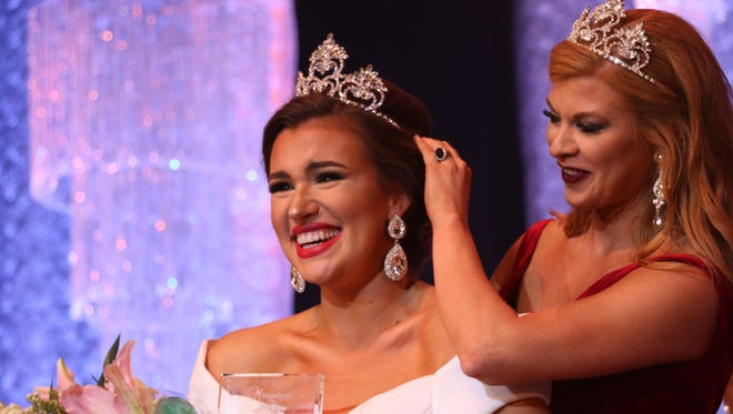 Mary Elizabeth Stringer, right, crowns Emma Grace McGrew of Booneville as the new Miss Hospitality during the 2017 Miss Hospitality Pageant at the Saenger Theater on Saturday.