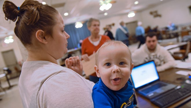 Tanya Johnson, left,  brought her son, Rhylen Miley, to have her taxes done Wednesday, Feb. 3, 2016 at Burt J. Aspers American Legion, Chambersburg. AARP Tax Aide Program was in session at the facility to help folks prepare their 2015 taxes.