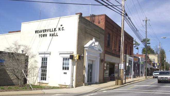 Shope's, the yellow two-story building at the far right, was an institution in downtown Weaverville for more than a century.