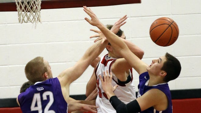 Elder and La Salle players battle for a rebound during their Greater Catholic League game Friday night. The Panthers started the season 16-0 for the first time since the 1971-72 season. Both teams are now 2-1 in the league.