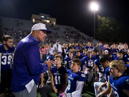 Sevier County head coach Tony Linginfelter congratulates