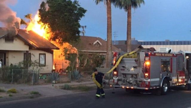 Phoenix firefighters battled a house fire downtown Thursday morning.