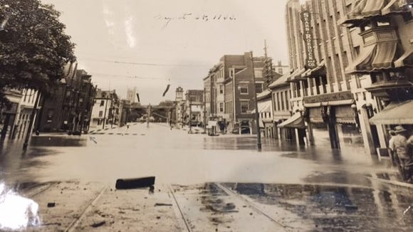 The Codorus Creek made its way well into the city's downtown the Flood of 1933. Notice the trolley tracks in the foreground in this West Market Street scene. The storm prompted Depression-era cleanup and buildup of the banks of the Codorus, which helped shape the creek front as we know it today.