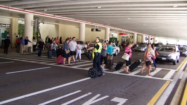 Passengers exit Southwest Florida International Airport in  this file photo.
