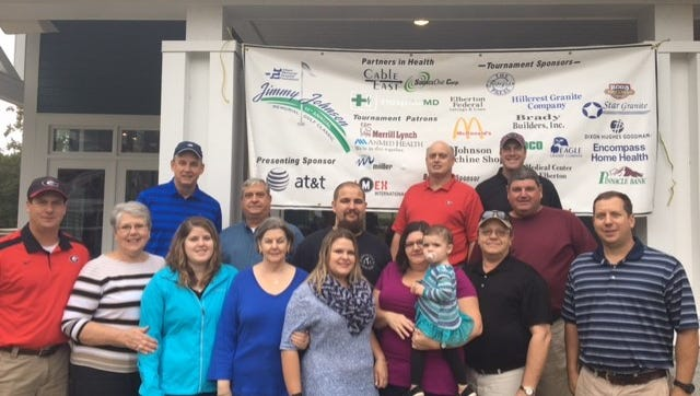 Representing the Jimmy Johnson family at the 11th annual Jimmy Johnson Memorial Golf Classic are, in the front row from left, Clay Johnson, Vickie Johnson, Conner Johnson, Shirley Johnson, Brooke Rice Shepherd, Kim Johnson Rice holding granddaughter Sadie Rae Hudson, Travis Rice and Clarke Johnson. In the back row, from left, are AT&T area manager-external affairs Stan Shepherd, Steve Johnson, David Shepherd, foundation chairman Chris Smith, Hospital CEO Brandon Clary and Greg Johnson.