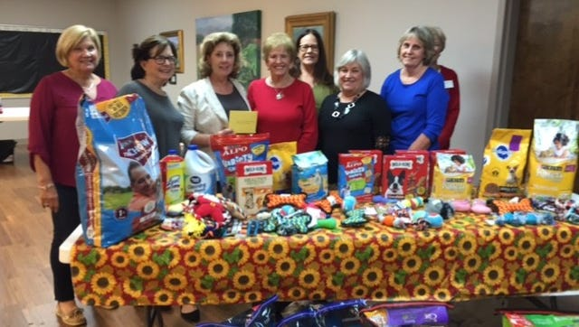 Shown from left are Hartwell Service League members, Beth Mewborn, Margo Seagraves; Humane society director Donna Madkiff, Kay Cleveland, Carol Mamay and Vivian Davis; and back row from left are Karen Seikbeil and Anne Murray.