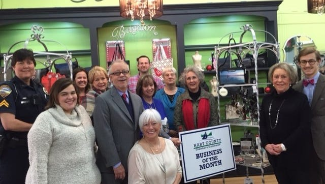 Shown from left to right in front row are Jenn Johnson, Earl Johnson,  owner; seated Mary Lynn Johnson, owner; Charlotte Keeble and Patrick Sowell; and back row are Hart Chamber member Kay Ankerich, and Bailes Cobb Department Store employees, Lauren Callaway, Nancy Hardigree, Keith Johnson, Lynn Johnson, Mary Duke and Pudge Smith.