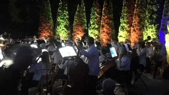 The Blue Ridge Orchestra played against a projected light show at the Arboretum's Summer Lights.