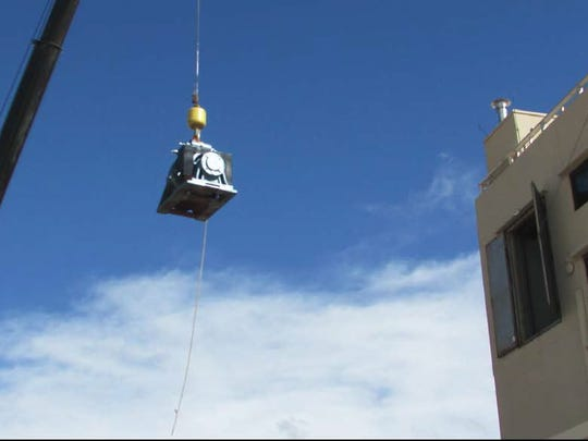A crane was used to install new motors in the primary elevator system at Carlsbad Caverns National Park.