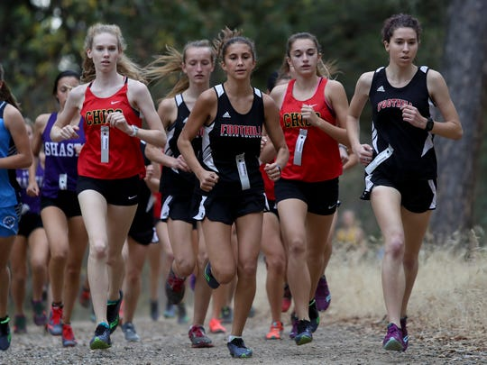 Foothill's Payton Osborne, right, and Rize Oliveira, center, and run during a 2017 cross country meet.