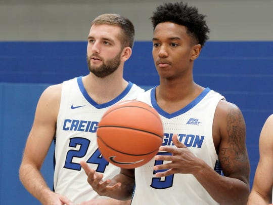 In this Oct. 16, 2019, photo, Ty-Shon Alexander (5) and Mitch Ballock (24) watch during Creighton's NCAA college basketball media day in Omaha, Neb. (AP Photo/Nati Harnik)