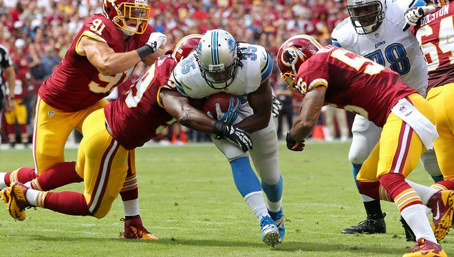 Detroit Lions running back Joique Bell (35) scores a touchdown against the Washington Redskins in the first quarter at FedEx Field in Landover, Md. on Sept. 22, 2013.