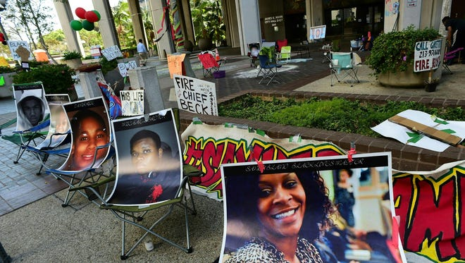 Photographs of African Americans killed by police line the Los Angeles encampment of activists associated with the Black Lives Matter movement, Aug. 12, 2016.