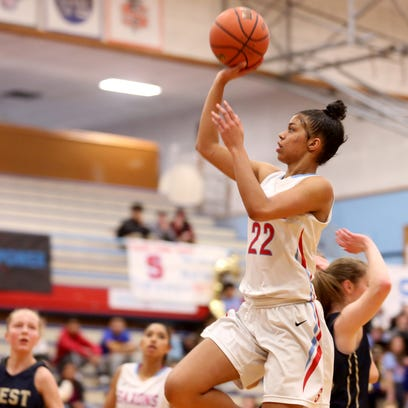 South Salem's Evina Westbrook (22) goes for two points