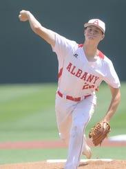 Albany starting pitcher Ryan Hill throws a pitch Stinnett