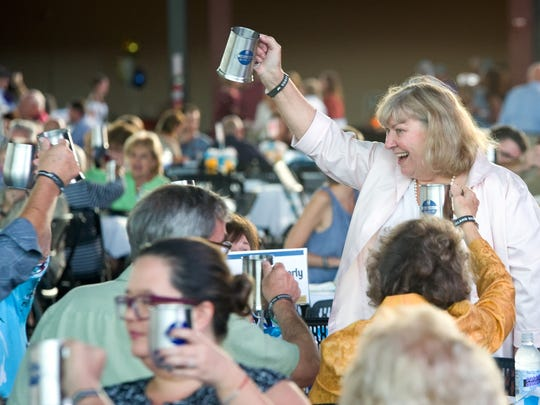 Attendees celebrate a fun night at a previous Oktoberfest to benefit Elder Care Services.