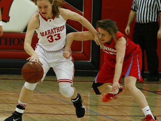 Marathon's Amanda Kind, steals the ball away from Newman's