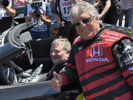 Sam Schmidt and Mario Andretti celebrate after the