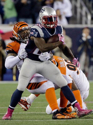 New England Patriots running back Stevan Ridley (22) runs against the Cincinnati Bengals in the second half Sunday, Oct. 5, 2014, in Foxborough, Mass.