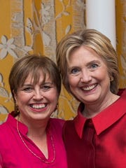 Carol Evans and Hillary Clinton at Clinton's birthday celebration in New York City last year.