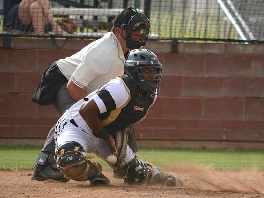 Abilene High catcher Terrell Franklin blocks a ball