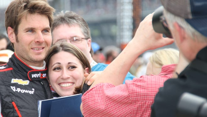 Will Power celebrates with fans after qualifying at Indianapolis Motor Speedway last year.