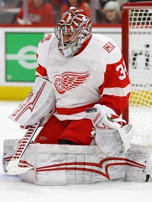 Red Wings goalie Petr Mrazek makes a save off of his glove against the Blackhawks at the United Center on Sunday, Jan. 14, 2018 in Chicago.