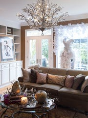 Holiday decorations and the decorative pieces added for the brunch complement the permanent furnishings in the living room.