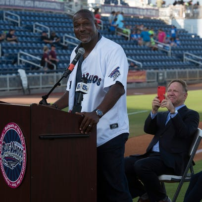 NFL Hall of Famer, Derrick Brooks, left, speaks to