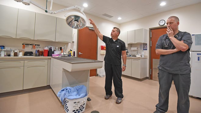 Brothers Abel and Jobe Hittinger show som of their new medical equipment during a tour for the News Journal on Thursday.