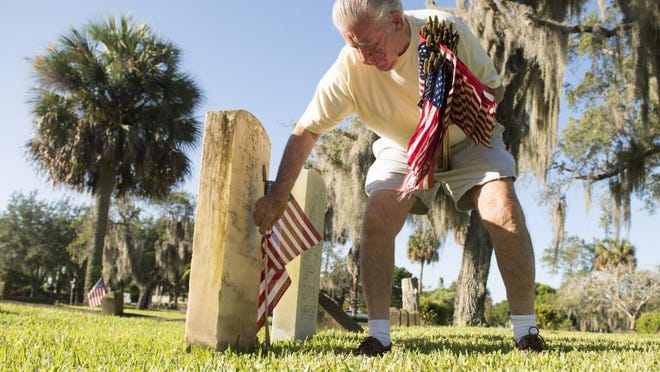 Images of American Legion Harold Johns Post 62 annual placing of American flags on the graves of deceased veterans at Fern Hill Cemetery in honor of Memorial Day in Stuart on Saturday, May 28, 2016.