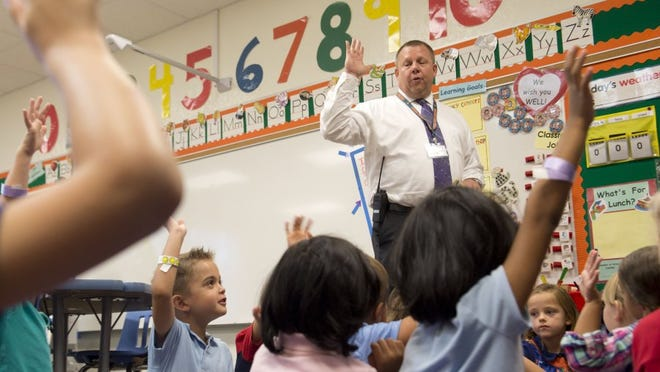 Todd Morrow, principal of Citrus Grove Elementary School, greets students on the first day of school in this 2016 file photo.
