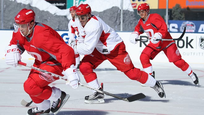 (From left) Pavel Datsyuk, Andreas Athanasiou and Gustav Nyquist skate during a practice session on the eve of their game versus the Avalanche at the 2016 Coors Light Stadium Series at Coors Field on Friday.