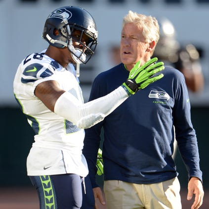 Aug 28, 2014; Oakland, CA, USA; Seattle Seahawks coach Pete Carroll (left) and cornerback Phillip Adams (28) before the game against the Oakland Raiders at O.co Colisuem. Mandatory Credit: Kirby Lee-USA TODAY Sports