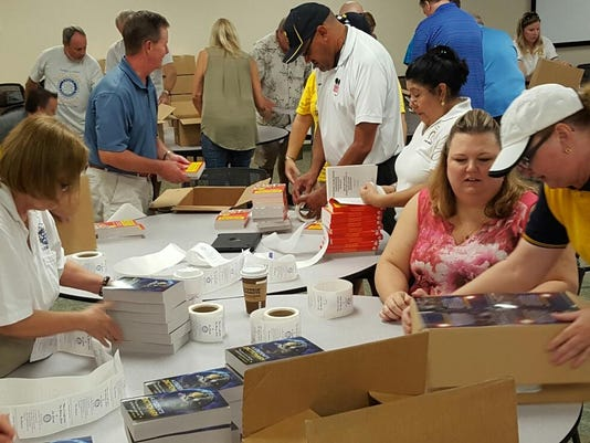 Lehigh Acres Rotary Members and Volunteers Label thousands of dictionaries f