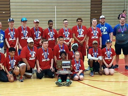 The St. Cloud Area Sluggers pose for a picture after their state adapted softball championship Saturday, June 3, 2017, at Coon Rapids.