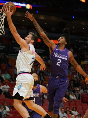 Mar 5, 2018; Miami, FL, USA; Miami Heat guard Goran Dragic (7) shoots the ball around Phoenix Suns guard Elfrid Payton (2) during the first half at American Airlines Arena. Mandatory Credit: Jasen Vinlove-USA TODAY Sports