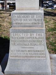 The base of the granite obelisk on the lawn of the