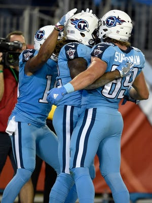 Titans wide receiver Kendall Wright (13), running back Derrick Henry (22) and tight end Phillip Supernaw (89) celebrate Henry's touchdown against the Jaguars on Thursday.