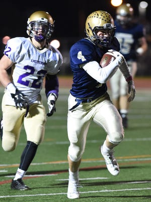 Our Lady of Lourdes High School's Corey Mullaly outpaces Amsterdam's Jako Rodecker during the Class A semifinals in Kingston on Friday.