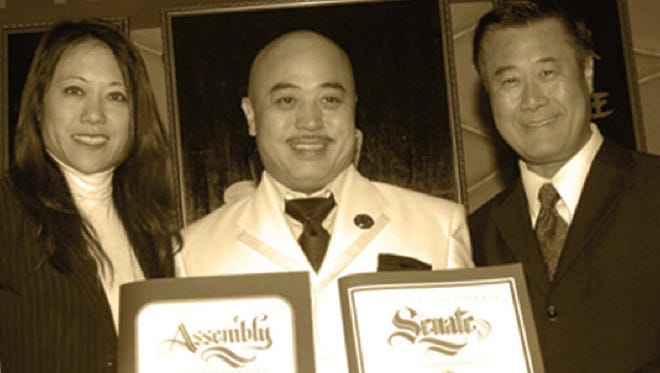 """Raymond """"Shrimp Boy"""" Chow, center, poses with state Sen. Leland Yee, right, and state Assembly member Fiona Ma, left, at the Chee Kung Tong spring banquet in San Francisco in March 2011. His grandmother gave him the nickname for his small stature."""
